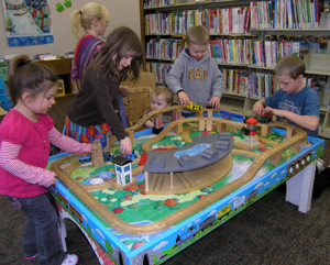 Children playing at train table